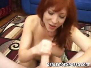 breasty redheaded milf strips, gives a pov titjob