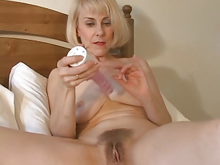 pleasant mama hazel may plays with her hairy pussy
