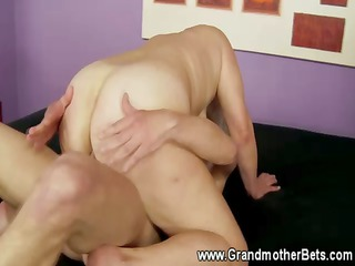 blond granny rides a hard penis