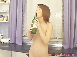 lascivious mamma sicking bottle neck in her pussy