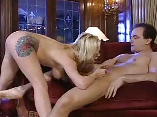 tattooed milf slut acquires a hardcore xxx titjob