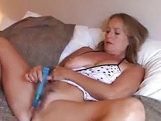 mature chick enjoys a smoke and a wank
