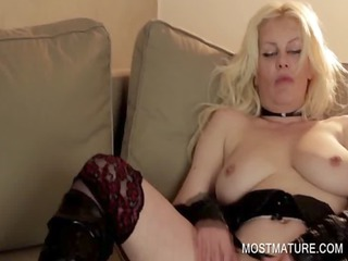 golden-haired mature rubbing vagina on couch