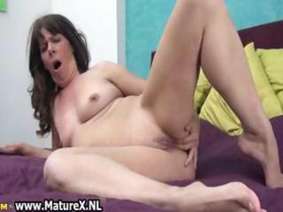 naughty mature floozy fucking her own part0