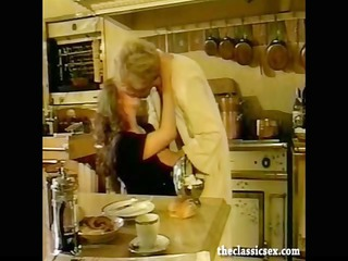 breasty retro hottie sucks cock in the kitchen
