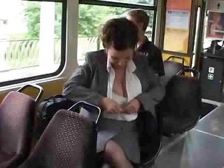 older milks her large tits on the bus.