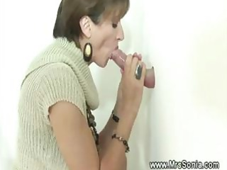 cuckold sees busty wife engulfing gloryhole dick