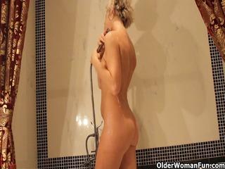 sexy older mom takes a bathroom and masturbates