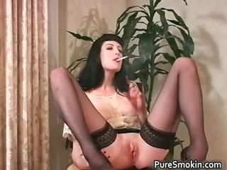 sexy brunette hair slut smokes cigarette