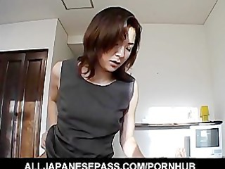 japanese mother i in an office suit sucks a large
