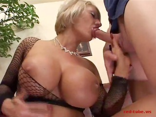 big boobed milf sucks cock and then sits on it on