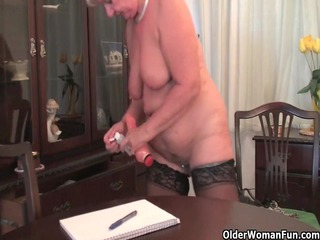 obese granny in nylons plays with fake pecker