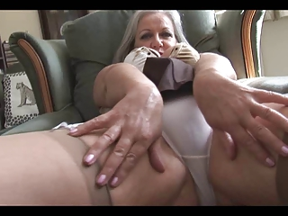 attractive breasty granny striptease