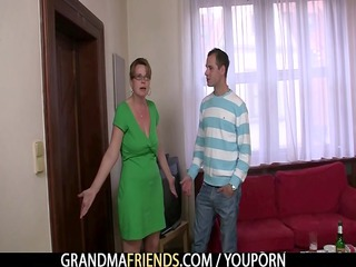 sexy older woman takes rods at one time