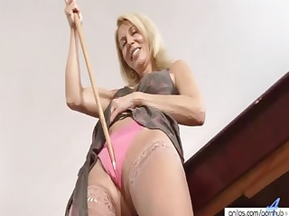blonde cougar with a hairy muff is using a pink