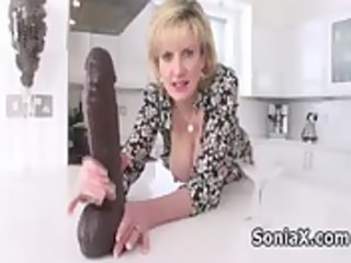 naughty mature playing with huge dildo
