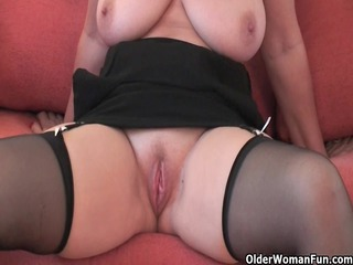 gracious grandma in stockings shows her big boobs