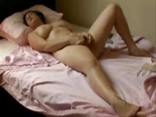 my hot mum fingering on her bed. hidden livecam