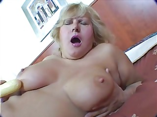 obese golden-haired older masturbation on ottoman