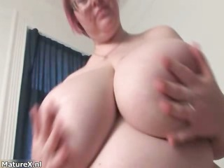 hot busty older woman plays with her