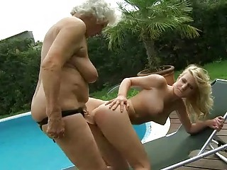 busty granny enjoys lesbo sex with legal age