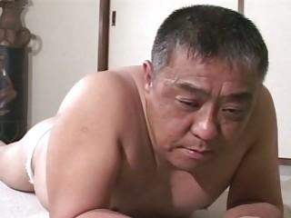older oriental guy receives spanking