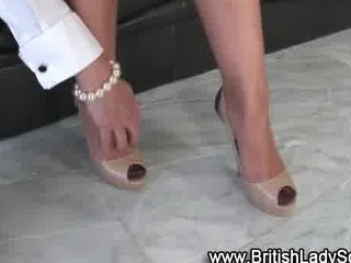 older brit femdom shoe posing for the camera