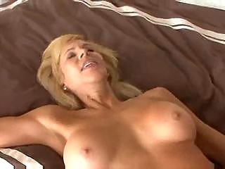 busty aged cougar seduces a younger guy