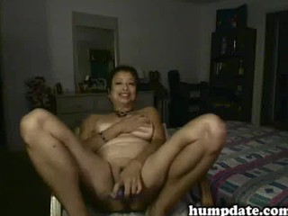 oriental aged chick toying her fur pie