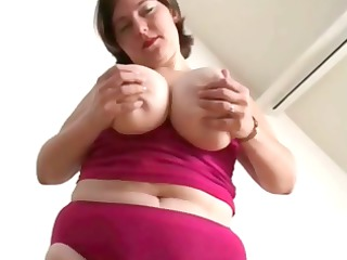 bulky wife with huge milk cans is stripping and