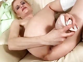 older blond fucks sextoy