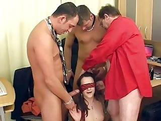 older brunette with the glasses having a group sex