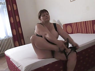 big breasted mom playing on her couch