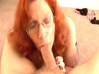 aged redhead acquires a ejaculation on her large
