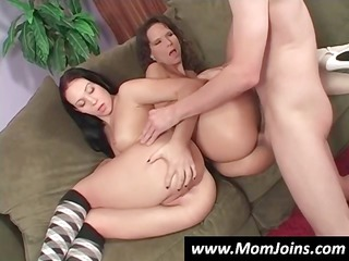 sexy dark brown mom and daughter share