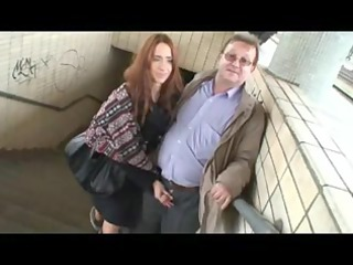 aged guy and young beauty having enjoyment in