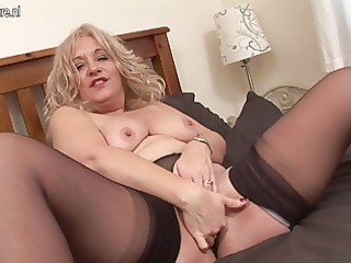 blond older floozy getting soaked on bed