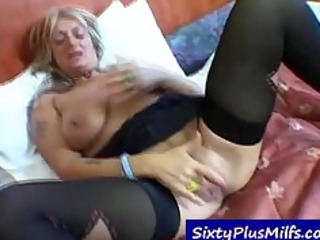 blonde gilf stuffing her steamy pussy with toy