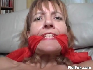 mature redhead in underware receives her