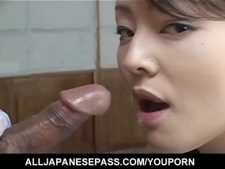glamorous japanese hottie sucks on a ball sac